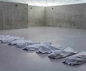 Maurizio Cattelan and line up the body bags image