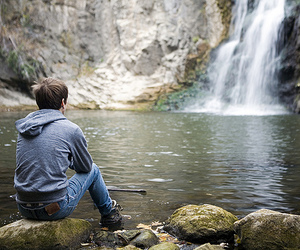 boy, lake, and waterfall image