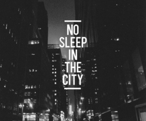 black and white, typography, and buildings image