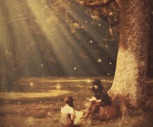 girl, tree, and book image