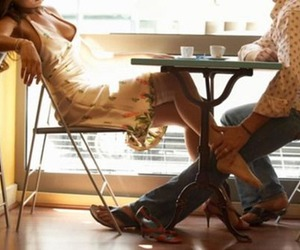 couple, footsie, and diner image