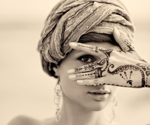 arabic, brown eyes, and henna image