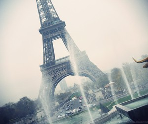 eiffel tower, fog, and water image