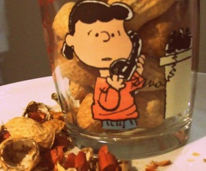 girl, peanuts, and glass image