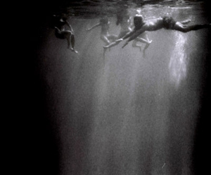 black and white, underwater, and water image