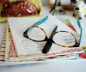 glasses, notebook, and pen image