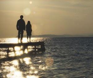 amanda seyfried, dominic cooper, and beach image