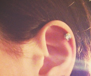 ear, girly, and pearcing image
