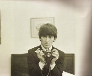 george harrison, the beatles, and camera image