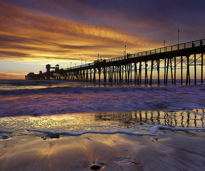 beach, pier, and sunset image