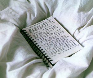 notebook, bed, and book image