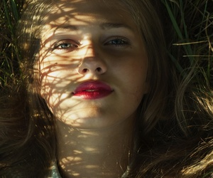 girl, red lips, and laying down image