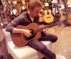 tom felton and guitar image