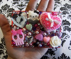 compact, hello kitty, and mirror image