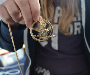 the hunger games, necklace, and mocking jay image
