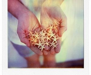starfish, hands, and stars image