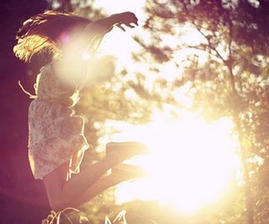 girl, sun, and jump image