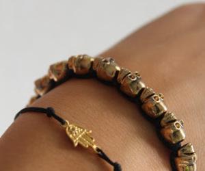 bracelet, gold, and skull image