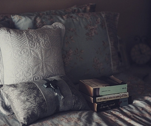 bed, books, and cushions image