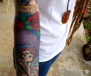 beautiful tattoo, dreads, and grateful dead image