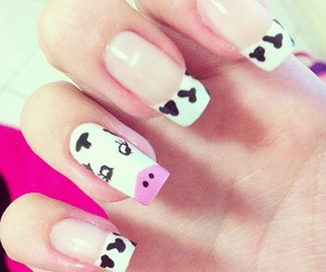 nails and cow image