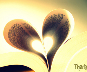 book, heart, and light image