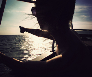 girl, sun, and boat image
