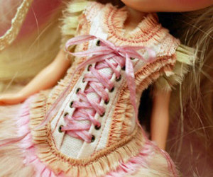 corset and doll image
