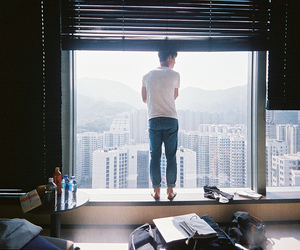boy, window, and city image