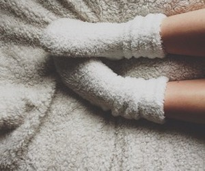 bed, cozy, and feet image