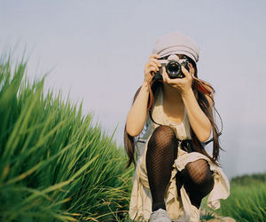 camera, girl, and grass image