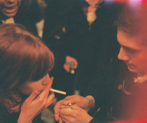 girl, boy, and cigarette image