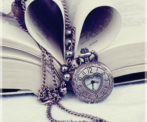 book, clock, and heart image