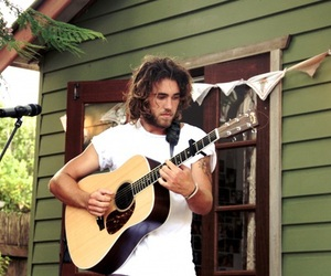 matt corby, boy, and guitar image