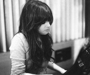 zooey deschanel, black and white, and piano image