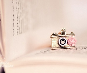 book, camera, and pink image
