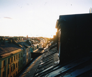 roof, city, and sun image