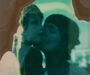 child, mother, and polaroid image