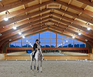 barn, stable, and river edge equestrian image