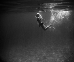 black and white, sunlight, and swim image