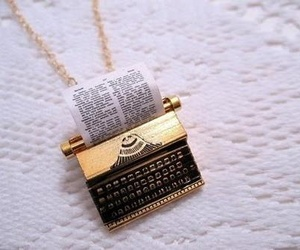 necklace, typewriter, and accessories image