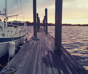 coast, dock, and sailboat image