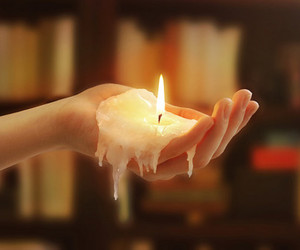 candle, hand, and fire image