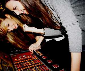 blond and brunette, casino, and crazy image