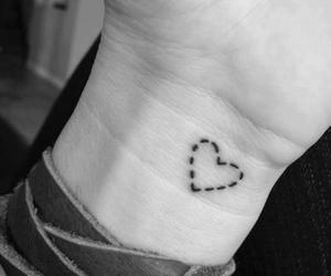 hand, heart, and tattoo image
