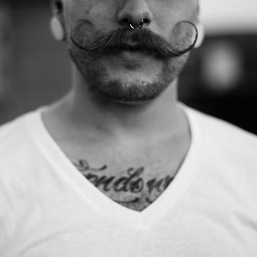 tattoo, piercing, and mustache image