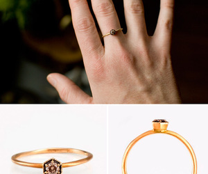 black, gold, and ring image