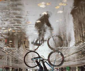 bicycle, rain, and trip image