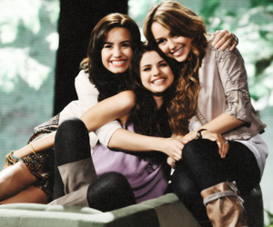 selena gomez, demi lovato, and miley cyrus image