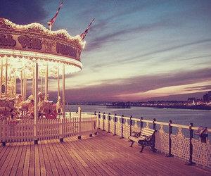 carousel, light, and sky image